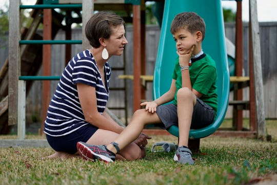 """Rachel Scott, left, talks with her son, Braden, in Tomball, Texas on Friday, March 29, 2019. """"Everyone is desperate for some magical thing"""" to cure the kids, said Rachel. Braden developed acute flaccid myelitis, or AFM, in 2016."""