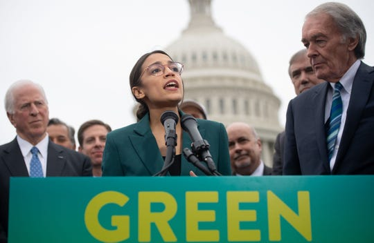 Congresswoman Alexandria Ocasio-Cortez speaks during a March press conference to announce Green New Deal legislation to promote clean energy programs.