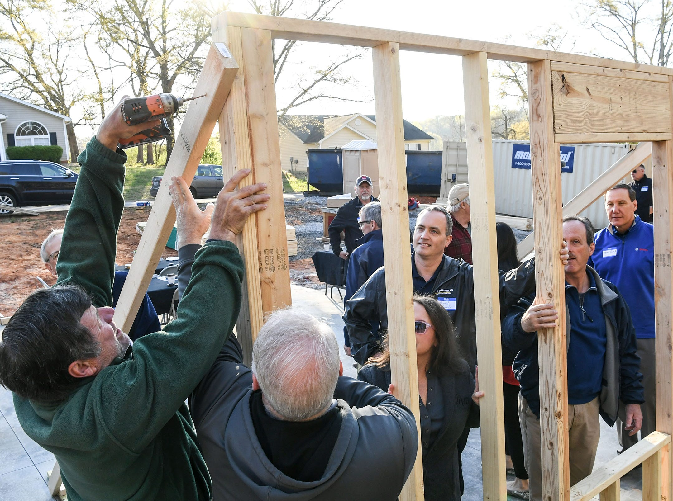 Phil Reamy, a volunteer for Habitat for Humanity of Anderson County, helps raise a wall at a home build for new homeowner recipient Victoria Santos in Anderson Thursday. The home is the eighth on Melrose Place in Anderson since Clemson football players, including Deshaun Watson, helped built the first in the fall of 2015.
