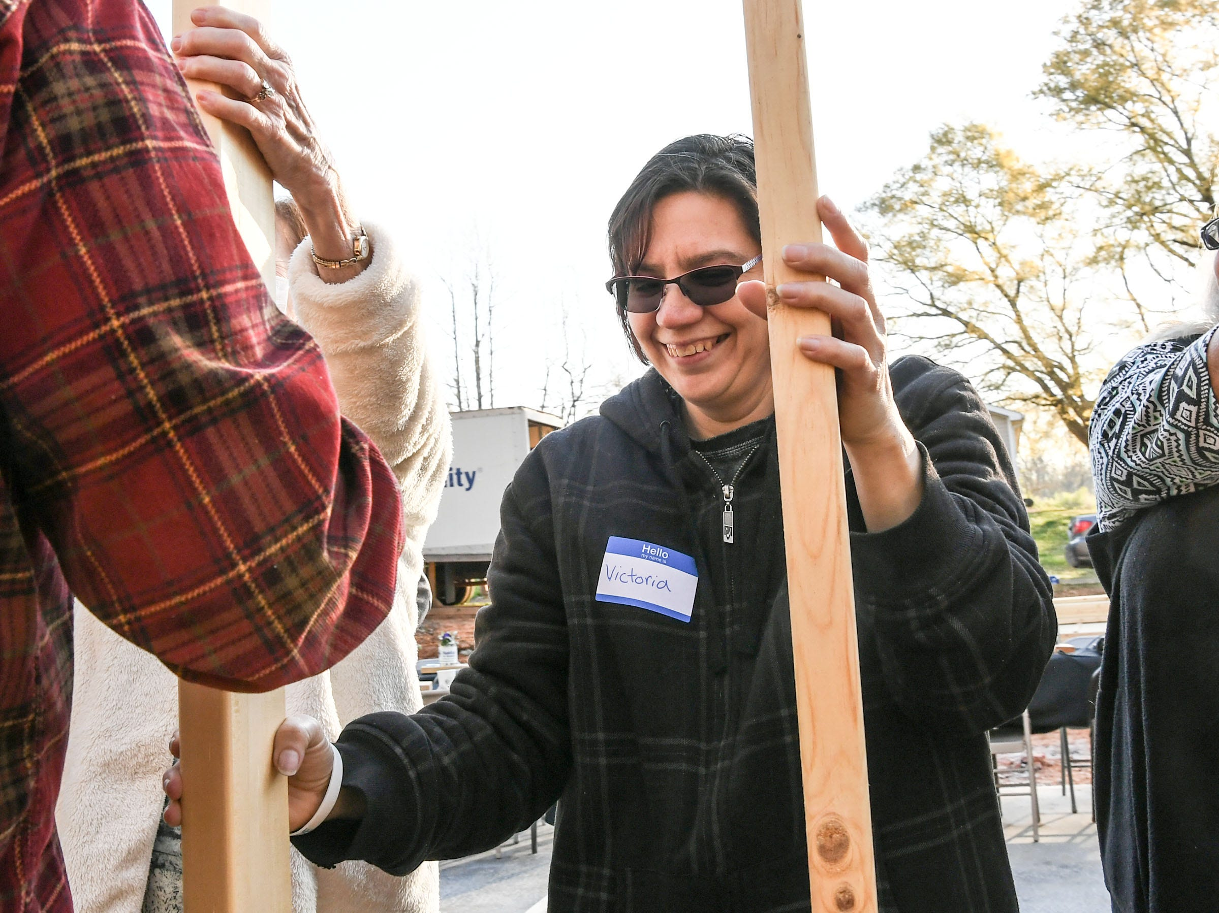 New homeowner recipient Victoria Santos smiles after helping raise a wall for her future home at a Habitat for Humanity of Anderson County home build in Anderson Thursday. The home is the eighth on Melrose Place in Anderson since Clemson football players, including Deshaun Watson, helped built the first in the fall of 2015.
