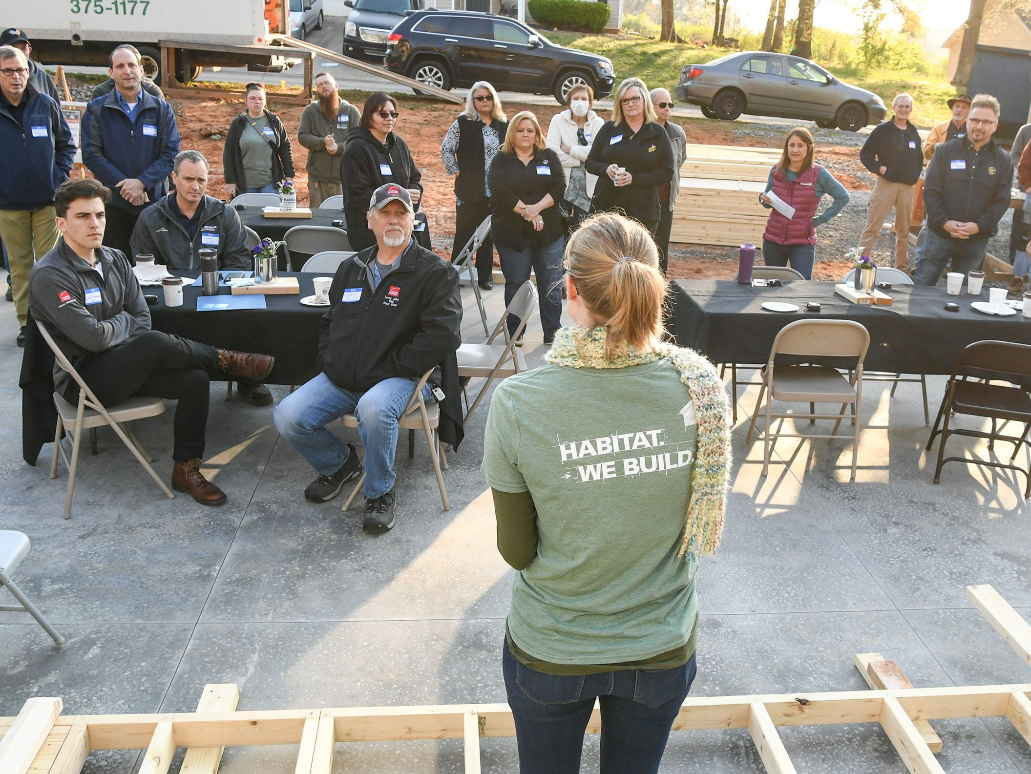 Kylie Herbert, development director for Habitat for Humanity of Anderson County welcomes volunteers ready for a wall-raising event for new homeowner recipient Victoria Santos in Anderson Thursday. The home is the eighth on Melrose Place in Anderson since Clemson football players, including Deshaun Watson, helped built the first in the fall of 2015.
