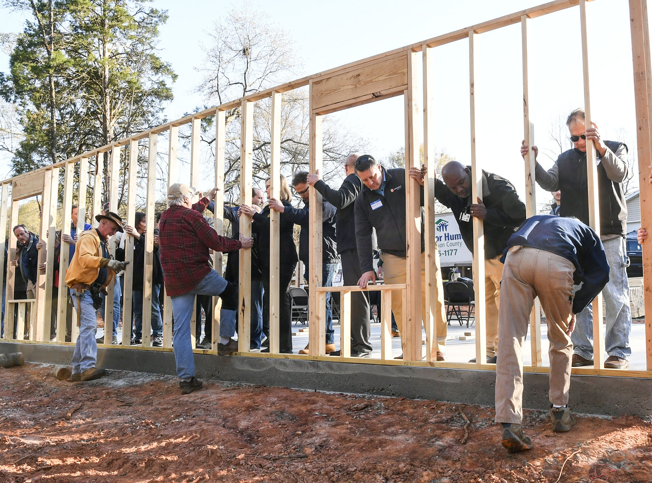 The Habitat for Humanity of Anderson County and group of 24 volunteers joined together for a wall-raising event at a home build for new homeowner recipient Victoria Santos in Anderson Thursday.