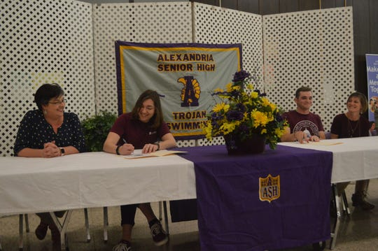 Alexandria Senior High swimmers Christine Goodman (second from left) and Jacob Bollinger (second from right) signed with Centenary on March 27.