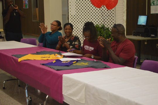 Alexandria Senior High track and field sprinter Ce'Nequal Sewell (third from right) signed with the University of Arkansas of Little Rock on Wednesday.