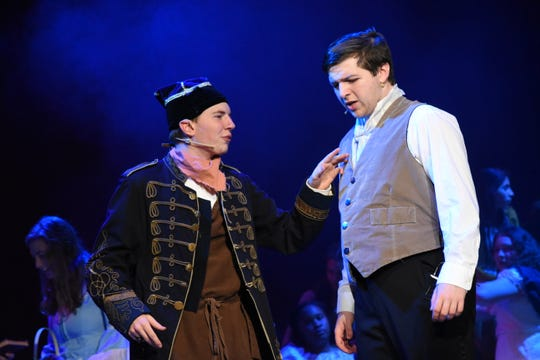 """Nico Zona stars (right) as Jean Valjean and Austin Tinsley as Thenardier in Pineville High School Theatre will present """"Les Miserables: School Edition"""" at 7 p.m. Thursday, April 4 through Saturday April 6 and at 2 p.m. Sundayat the Pineville High School Auditorium. Tickets are $13.50 for adults; $11.50 for seniors and $8.50 for students. For more information on tickets, visitwww.pinevillehigh.tix.com. """"Les Miserables,"""" based on the French historical novel by Victor Hugo,takes place in 19th century France. Jean Valjean is released from prison where he was unjustly imprisoned for stealing a loaf of bread. He breaks parole and begins a new life but he is pursued by a police inspector named Javert. Valjean adopts a young girl, Cosette, and vows to her dying mother he will care and protect her. As a young woman, Cosette falls in love with a young student revolutionary, Marius. Though Valjean tries to live a quiet life, he gets swept up in the Paris Uprising of 1832."""