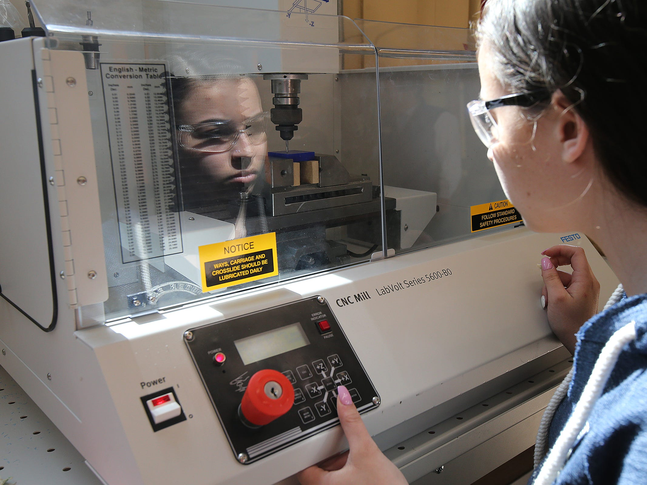 Sierra Reilly, 17, of Lacey Twp. cuts her initials into a block using coordinate geometry and computer numerical control (CNC) during a pre-engineering technology class at Ocean County Vocational Technical School in Jackson, NJ Thursday, April 4, 2019.
