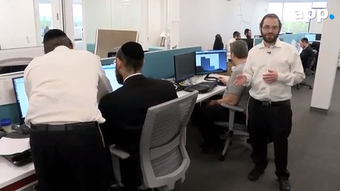 Bitbean owner Ephraim Arnstein gives a tour of his software development space in Lakewood.