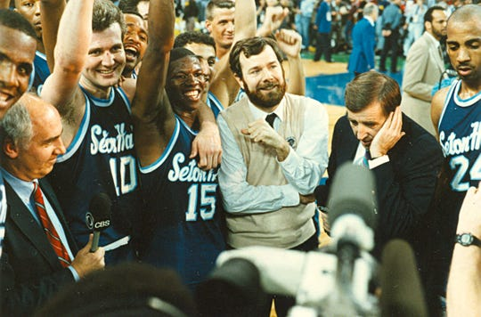Gerald Greene (No. 15) and Andrew Gaze (10) stand next to P.J. Carlesimo after Seton Hall beat Duke in the 1989 NCAA Tournament semifinals.