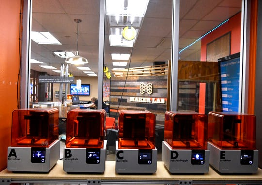 Three-D printers at rest in the Abilene Christian University Maker Lab on March 29.