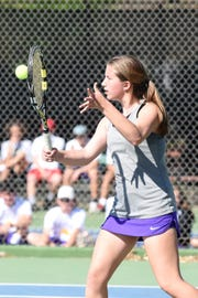 Wylie's Trinity Miller hits a shot during the District 4-5A girls singles final at Rose Park on Thursday, April 4, 2019. Miller won the match in three sets.