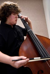 Mann Middle School eight-grader Cooper Smith practices on his string bass Jan. 19. The Abilene Youth Orchestra, an offshoot of the Abilene Philharmonic, held their auditions at the Williams Performing Arts Center at Abilene Christian University.