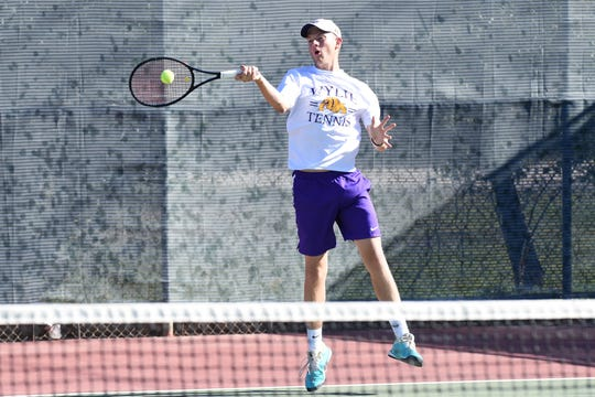 Wylie's Davyn Williford returns a serve during the District 4-5A boys singles final. Williford won in straight sets.