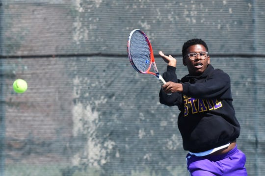 Wylie's Courtney Holmes follows through on a shot during the District 4-5A boys doubles playback at Rose Park on Thursday. Holmes and Anthony Zhang won to earn a trip to the region tournament.