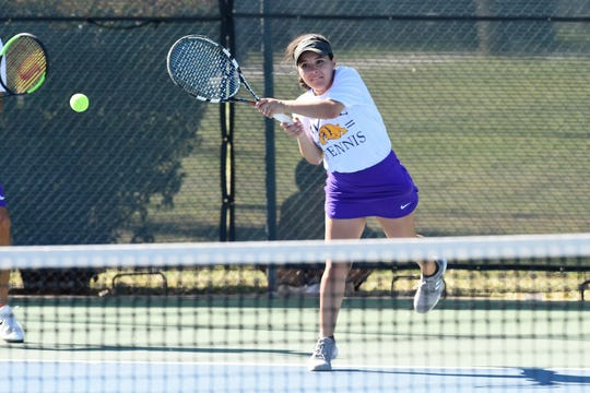 Wylie's Analeah Elias hits a backhand shot during the District 4-5A mixed doubles final. Elias and partner Lane Adkins bounced back to win the district title.
