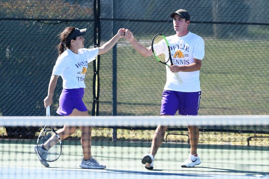 Wylie's Analeah Elias, left, and Lane Adkins celebrate winning a point during the District 4-5A mixed doubles final.