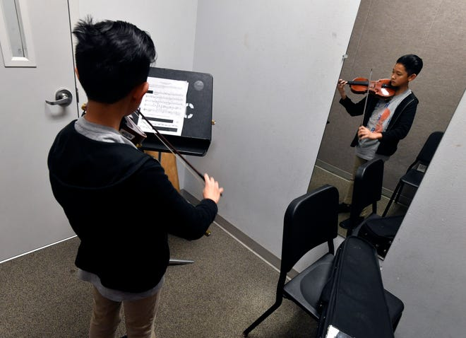 John Tran, an 8th-grade student at Madison Middle School, rehearses on his violin at Abilene Christian University's Williams Performing Arts Center on Jan. 19. He was auditioning for the Abilene Youth Orchestra, an offshoot of the Abilene Philharmonic.