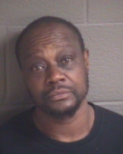 Darin Smith, 51, of Asheville is charged with robbing a convenience store with a machete in July 2018.