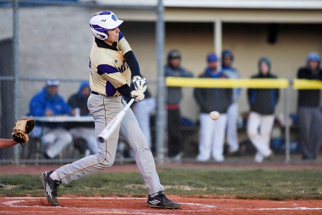 Zues Ponder swings in the game against Madison April 2, 2019 in Marshall.