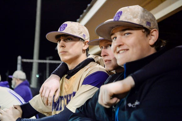 From left, Zeus Ponder, Caleb Pritchard and Logan Beaver watch the game against Madison from the dugout April 2, 2019 in Marshall.