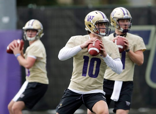 Washington quarterback Jacob Eason (10) drops to pass during the first day of spring NCAA college football practice, Wednesday, April 3, 2019, in Seattle.