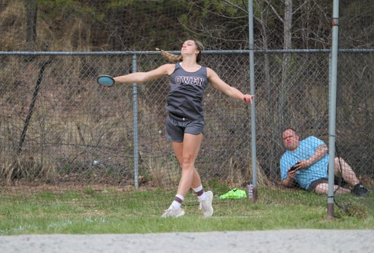 Senior Cehsney Gardner warms up before a track meet at Owen on April 4, when she once again broke the school record in discus.