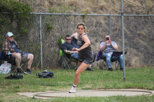 Owen's Chesney Gardner sets a school record with a 131-foot throw at home on April 4.