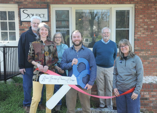 Connor Kees, the new owner of The Source for Well-Being, cuts the ribbon on April 4, marking a change in ownership of the Black Mountain business. Former owner of The Source, Whitney Madden and representatives from the Black Mountain-Swannanoa Chamber of Commerce joined Kees for the occasion. Back row, from to left to right: Allen Arcand, chamber volunteer and member; Kit Moorehead and Bob McMurray, chamber executive director. Front row, left to right: Madden, Krees and Kim Schroeder, chamber board member and owner of Black Mountain Coin Laundry.