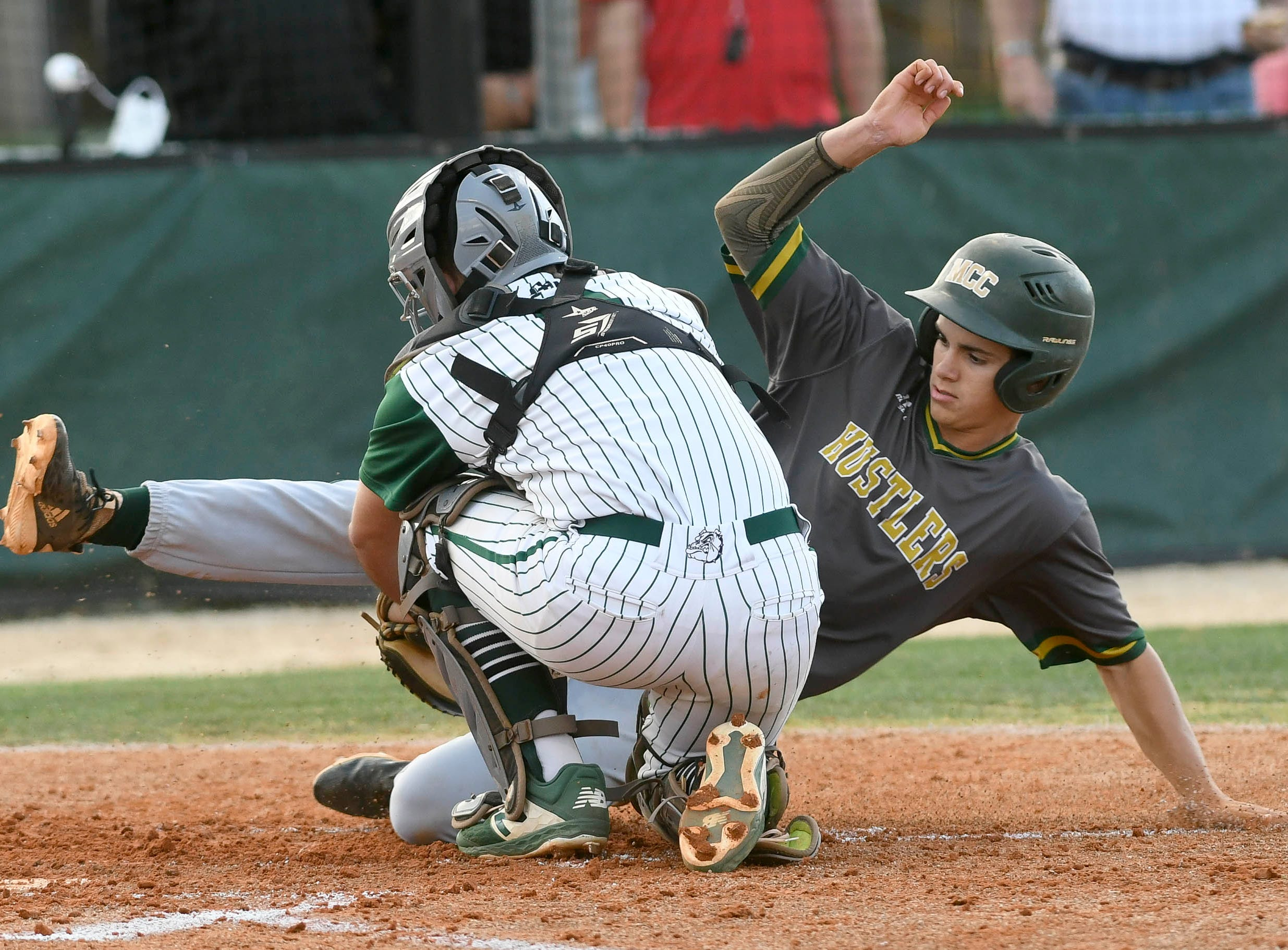 Melbourne catcher Jared Stevanus tags out MCC baserunner Zach Beolet during Wednesday's game at Florida Tech.