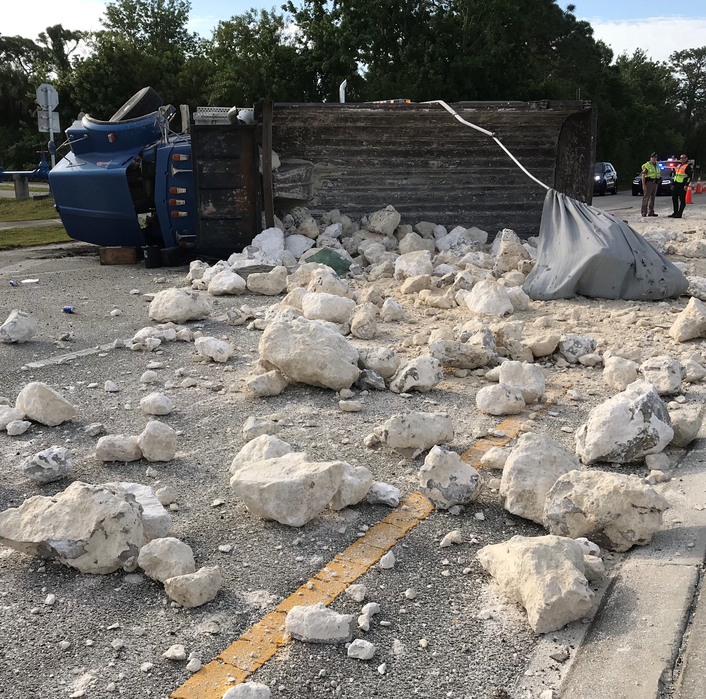 Dump truck flips over in Merritt Island, scatters rocks along roadway