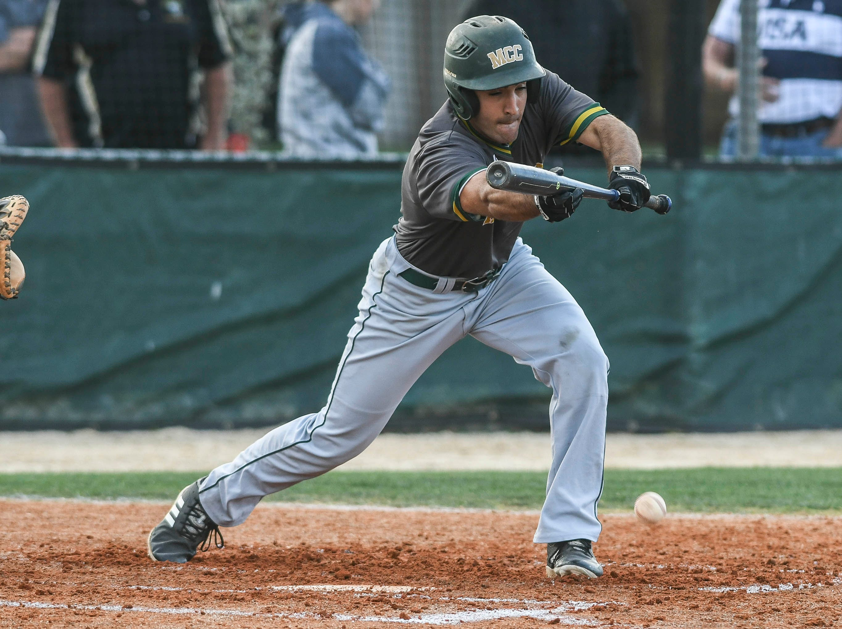 Anthony Zarzana of Melbourne Central Catholic attempts a bunt during Wednesday's game against Melbourne.