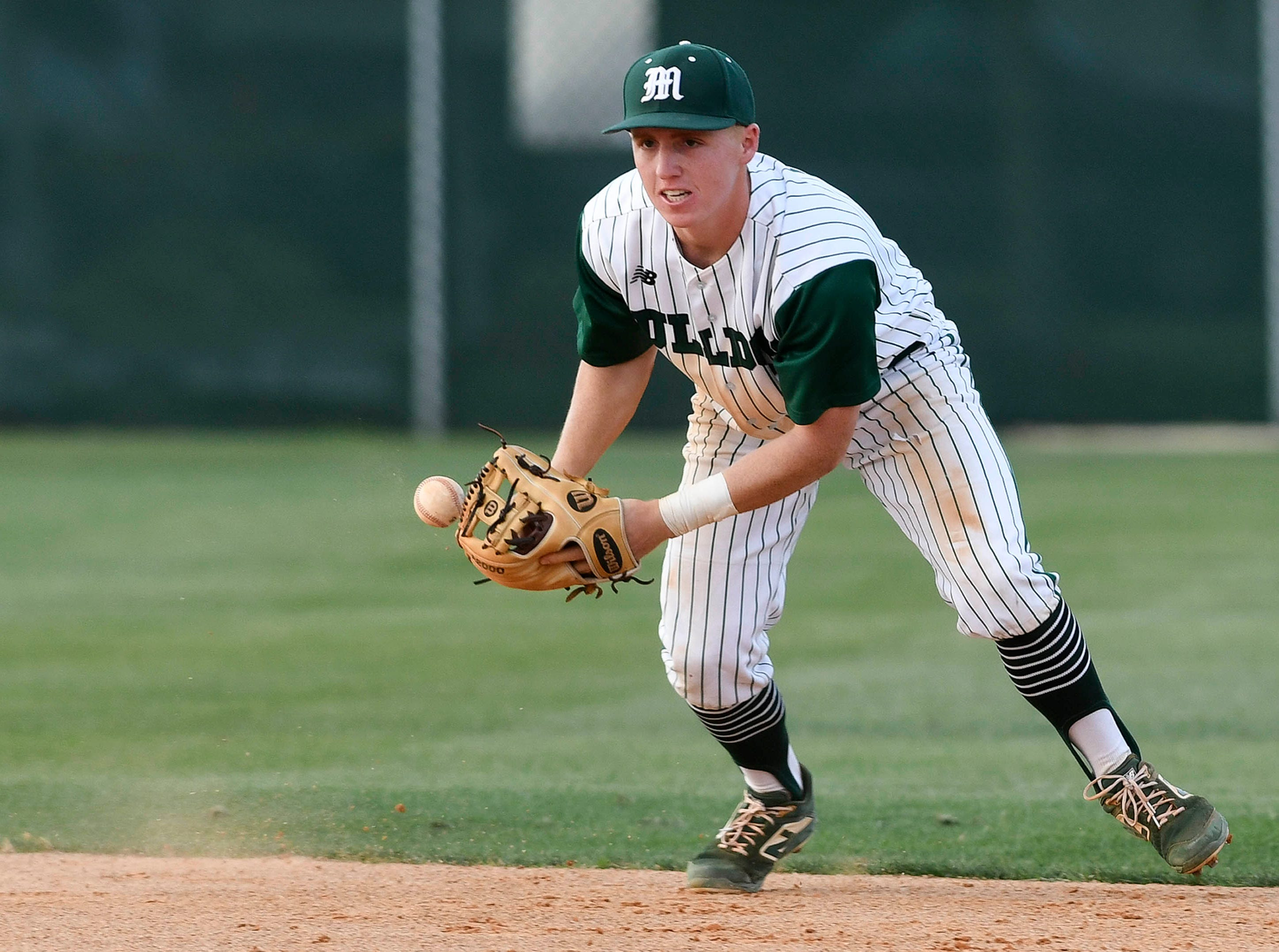 Melbourne SS Jason Blackstone bobbles a grounder during Wednesday's game against MCC.