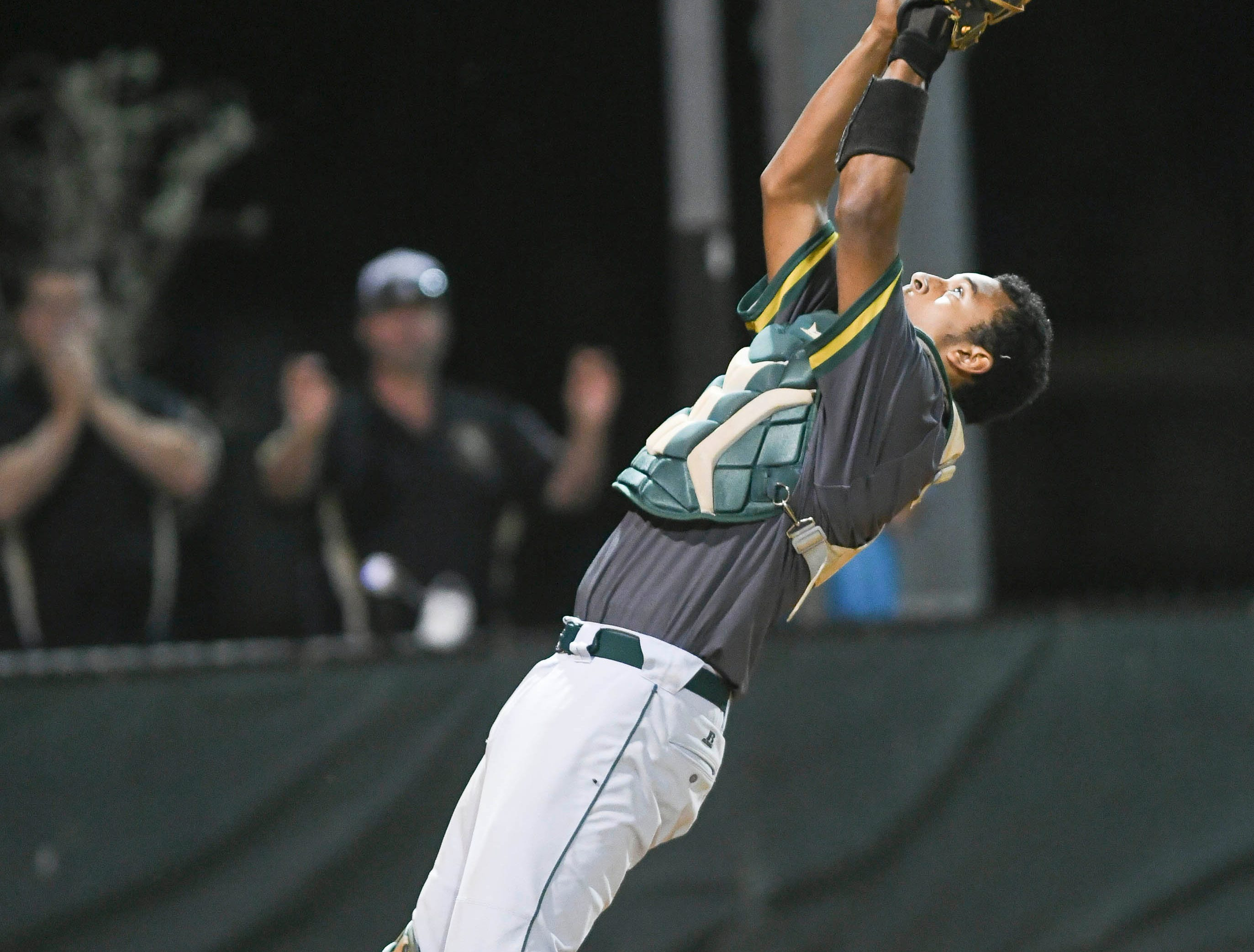 Melbourne Central Catholic catcher Kevin Espiritusanto catches the final out to preserve the 1-0 victory in Wednesday's game against Melbourne.