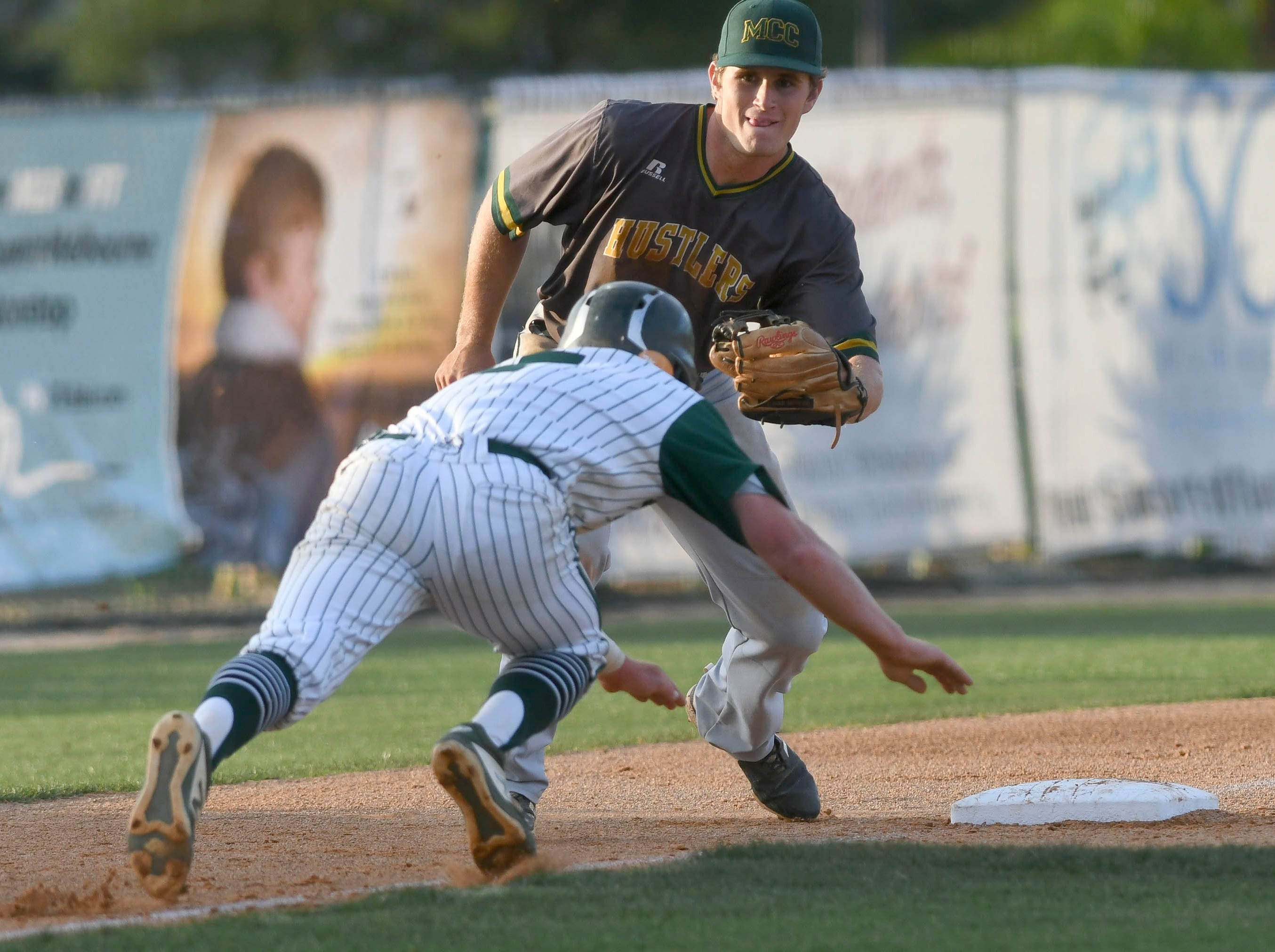 Melbourne Central Catholic third basemanJackson Taylor waits to tag out Melbourne baserunner Jason Blackstone during Wednesday's game.