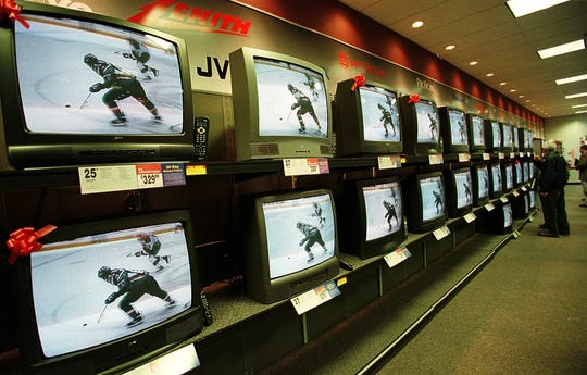 An array of new televisions greets shoppers at the opening of Circuit City in Williston on November 21, 1997.