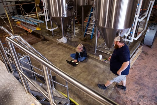Dawn Herrin (left), with Deutsche Beverage Technology, and Brandon Harper, co-owner of Nueces Brewing Company, work to get the brewery online on Thursday, April 4, 2019. The brewery is located at 401 S. Water Street in a building that was once a car dealership and later became a news station. Over the years several small businesses have taken over the space. The 67,000 square foot facility has been transformed into a craft brewery with plans to open in June.