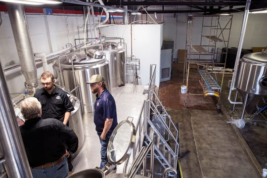 Brewmaster Michael Mankoschewski (clockwise from left), Alex Lockman, with Deutsche Beverage Technology, and Cale Moore, co-owner of Nueces Brewery Company, do a practice brew with water at the brewery on Thursday, April 4, 2019. The brewery is located at 401 S. Water Street in a building that was once a car dealership and later became a news station. Over the years several small businesses have taken over the space. The 67,000 square foot facility has been transformed into a craft brewery with plans to open in June.