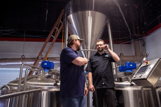 Cale Moore (left), co-owner of Nueces Brewing Company, and Alex Lockman, with Deutsche Beverage Technology, do a practice brew with water at the brewery on Thursday, April 4, 2019. The brewery is located at 401 S. Water Street in a building that was once a car dealership and later became a news station. Over the years several small businesses have taken over the space. The 67,000 square foot facility has been transformed into a craft brewery with plans to open in June.