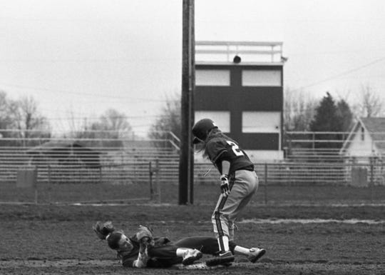 Unioto's Amy Shoemaker stretches to touch second base and force out Piketon's Mandy Little during the Scioto Valley Conference opener at Piketon in March 1993.