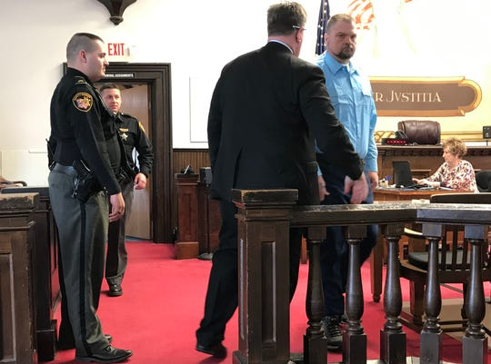 "George ""Billy"" Wagner III looks toward his family members as he enters the Pike County Common Pleas Court for his March 29, 2019, pretrial hearing."