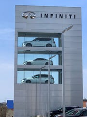 The 55-foot Infiniti showcase tower above I-71/75 in Fort Mitchell was filled with new cars for the first time April 4, 2019.