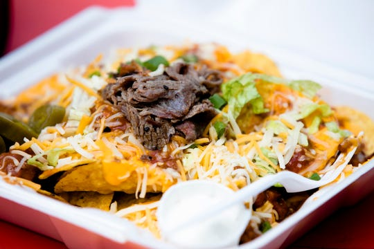 Tri Tip Nachos from the Tri Tip food truck on Thursday, April 4, 2019, at Fountain Square in Cincinnati, Ohio.