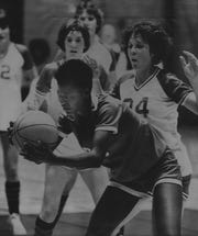 MARCH 24, 1979: Marilyn Banks of Hughes grabs the ball after receiving a pass in the Class AAA girls regional game against Oak Hills. Also pictured is Tracy McGinness (24) of Oak Hills.