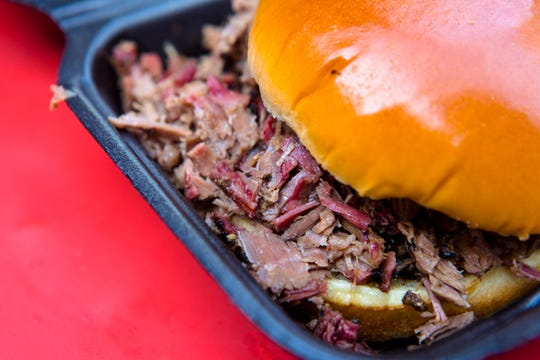 Brisket sandwich from the Just Q'In food truck, that specializes in BBQ, on Thursday, April 4, 2019, at Fountain Square in Cincinnati, Ohio.