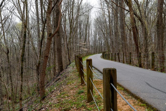 The winding path southward of the trail at the Clarksville Greenway entrance off of Pollard Road in Clarksville, Tenn., on Thursday, April 4, 2019.