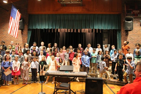 Third grade students performing in the choir