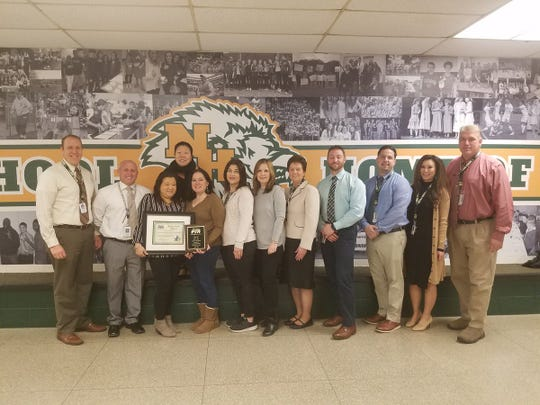 PTSA Officers with their award joined by North Hunterdon High School's administration team.