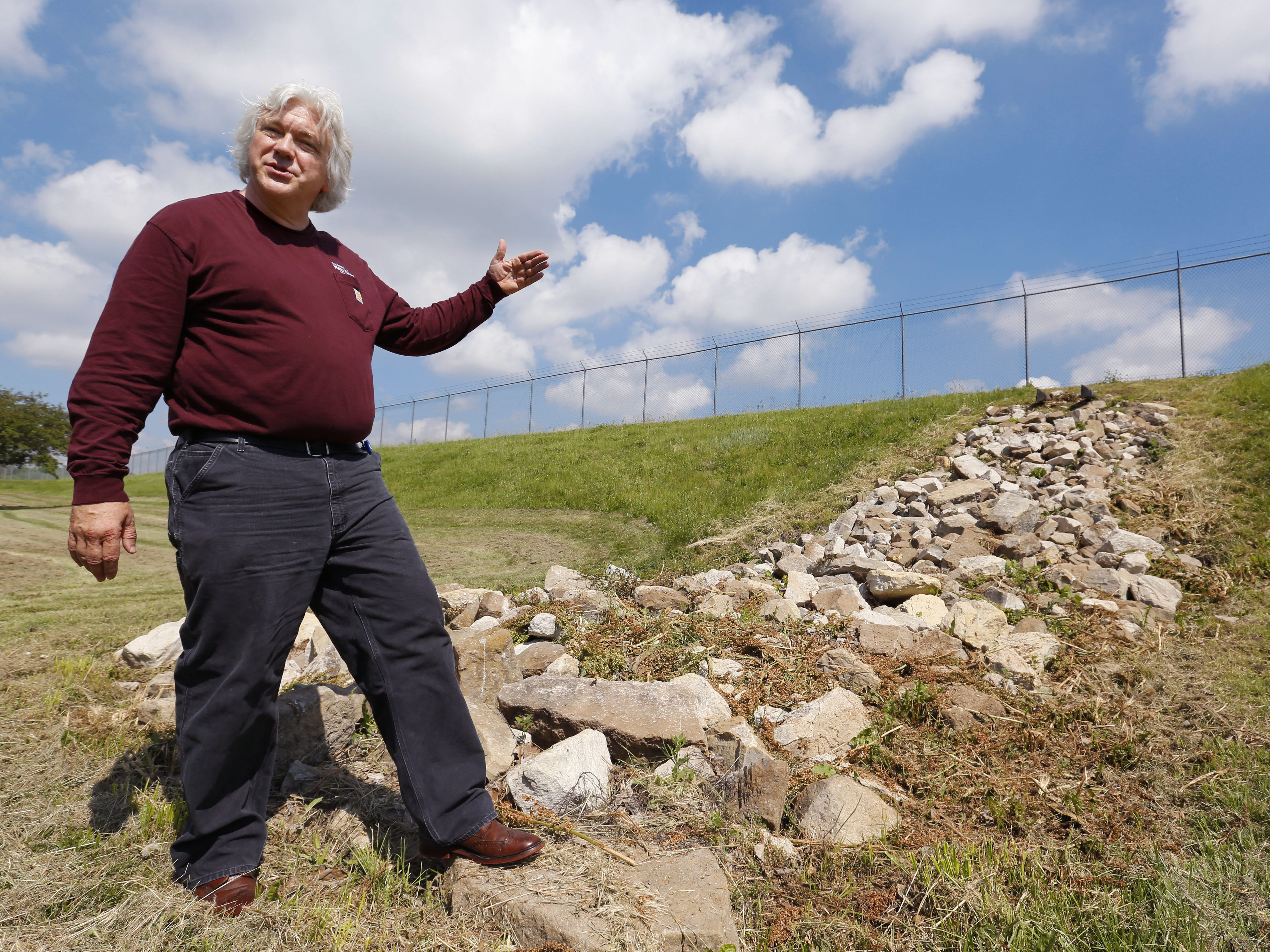 Bill Stowe shows the area where discharge from the de-nitrification units is expelled from the water works into the ground. Instead of placing it back into the river, where it would have to be removed again by other water treatment facilities, the water with a mixture of nitrates and salt is left to seep back into the ground.