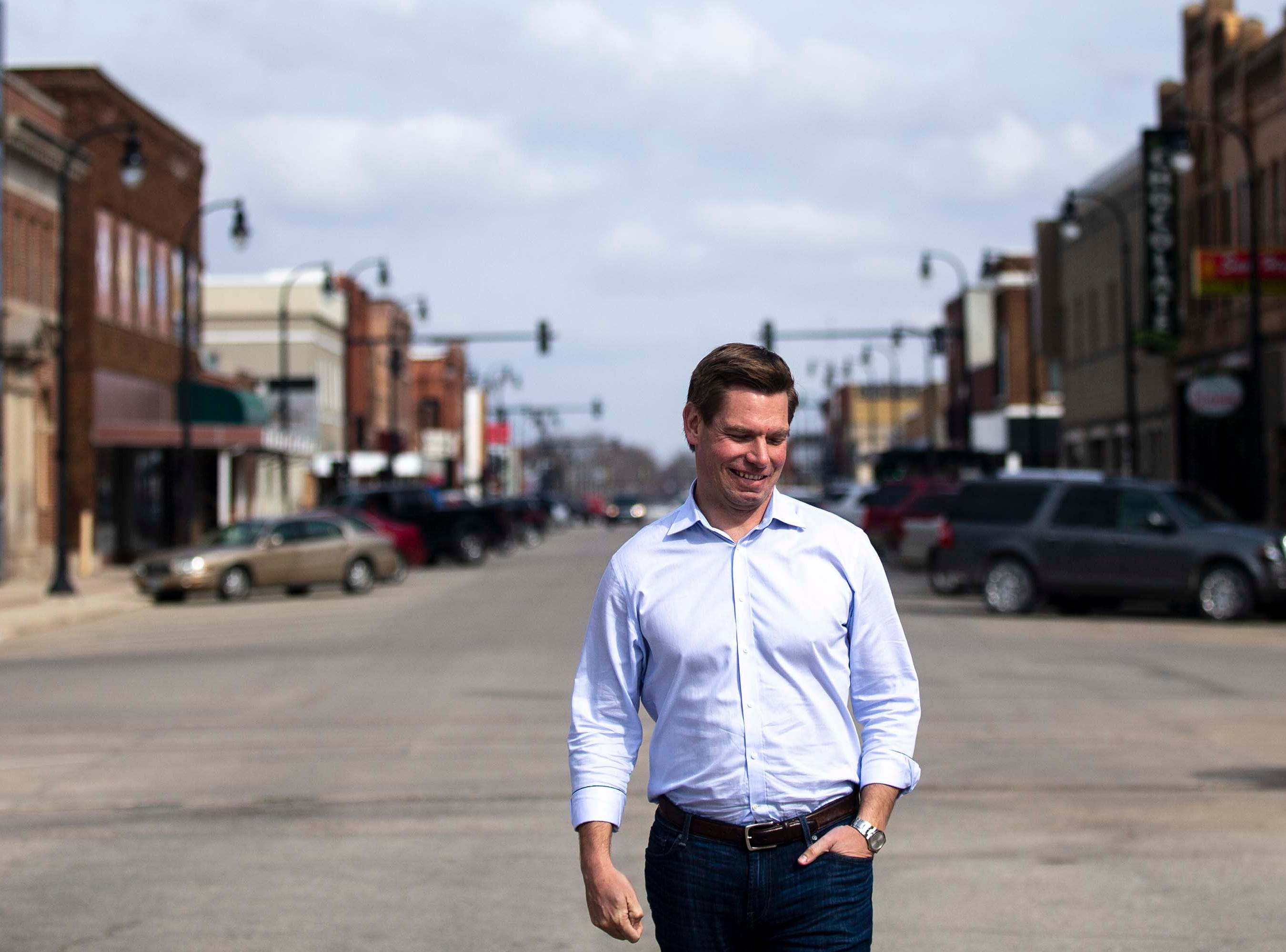 U.S. Rep. Eric Swalwell, D-CA, poses for a photo in downtown Algona, where he lived for three years as a child, on Monday, April 1, 2019, in north central Iowa. Swalwell made the trip to Iowa about a week before announcing he'll run for president.