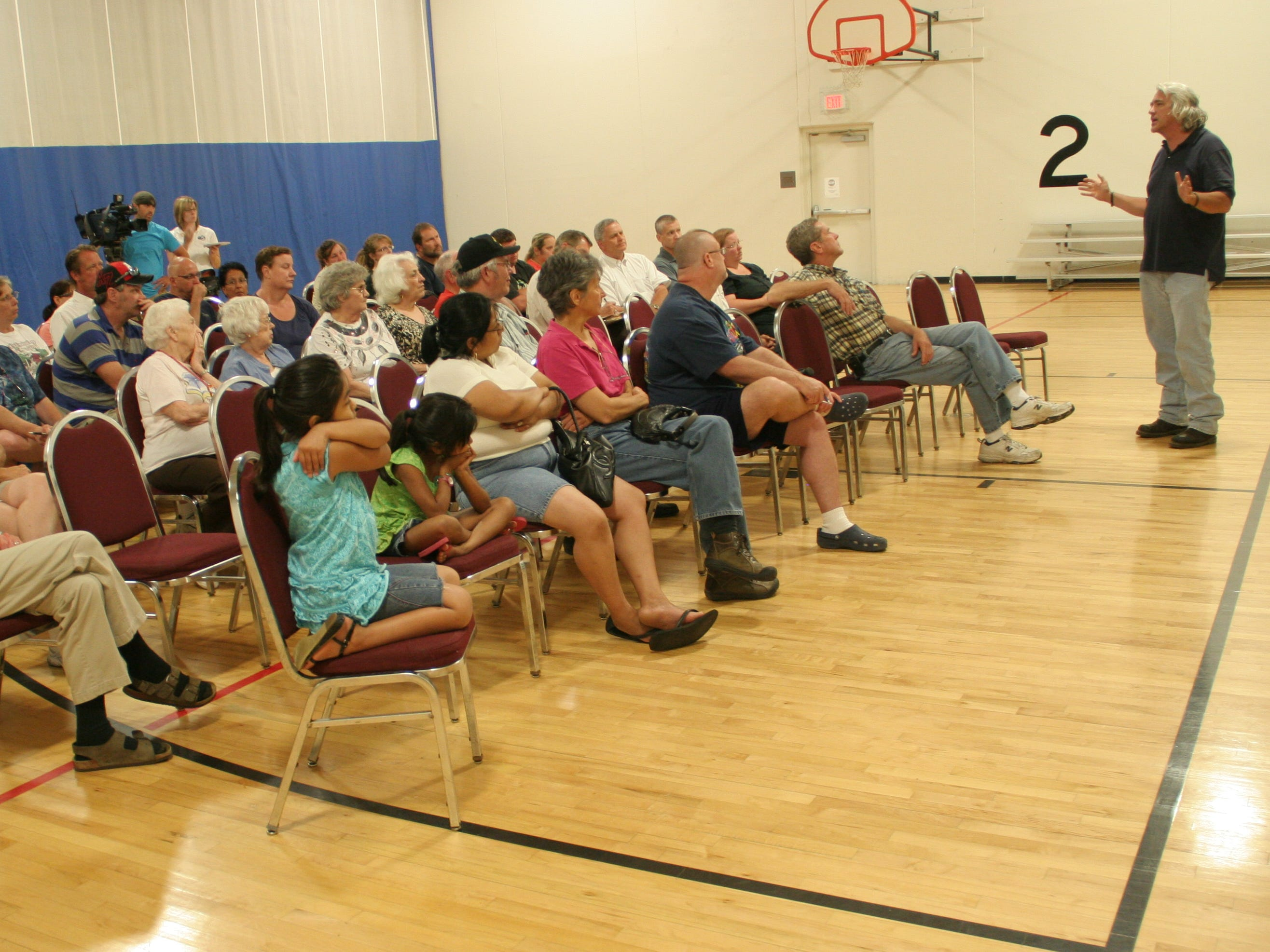 Bill Stowe tells a crowd of about 60 southside residents why their basements flooded with sewer water in 2010.