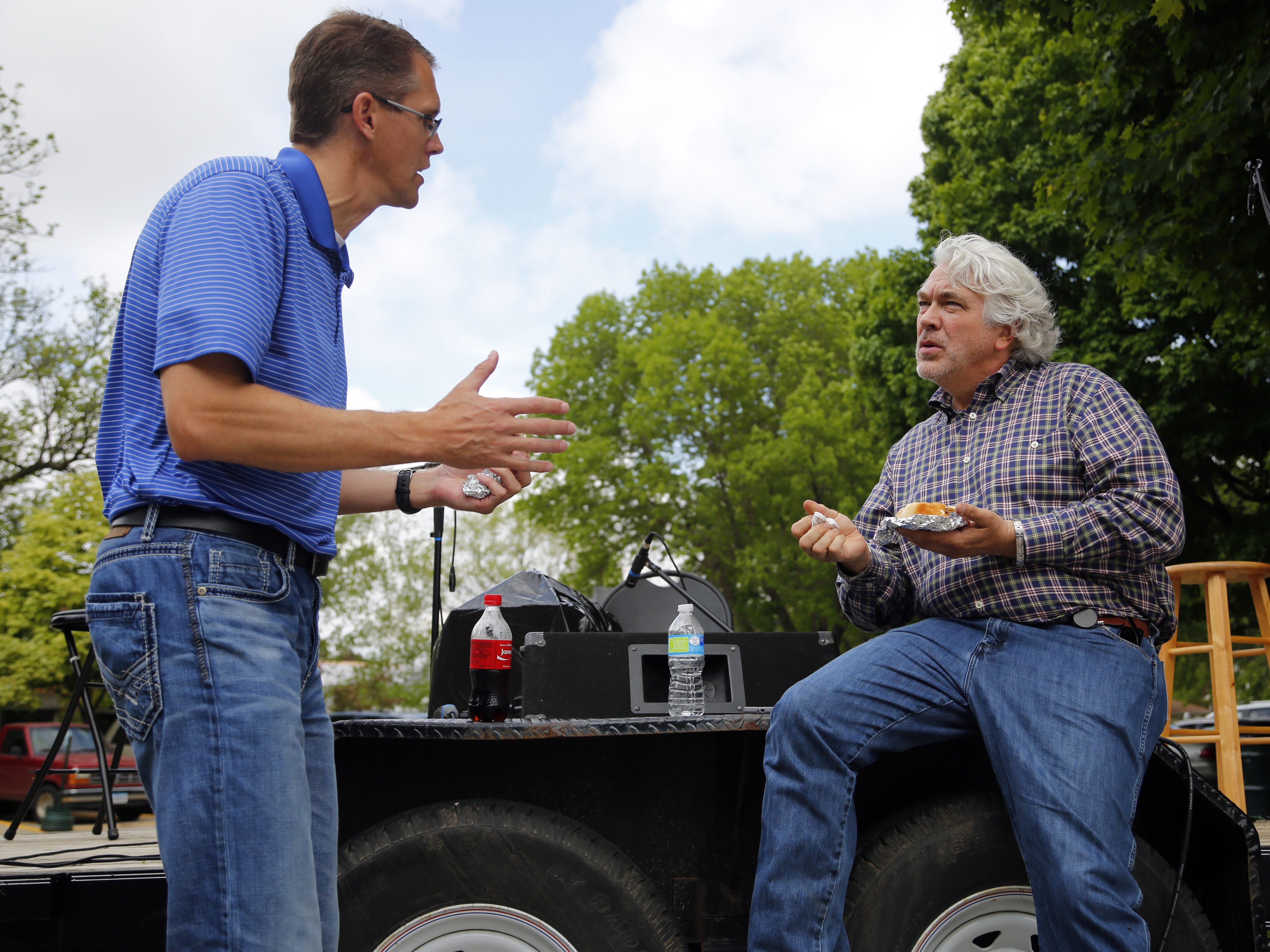State Sen. Randy Feenstra, R-Hull, and Des Moines Water Works CEO Bill Stowe talk over water issues at the Tulip Festival in Orange City in 2015.